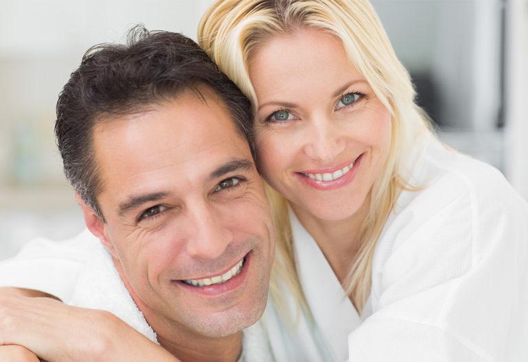Man and woman smiling hugging