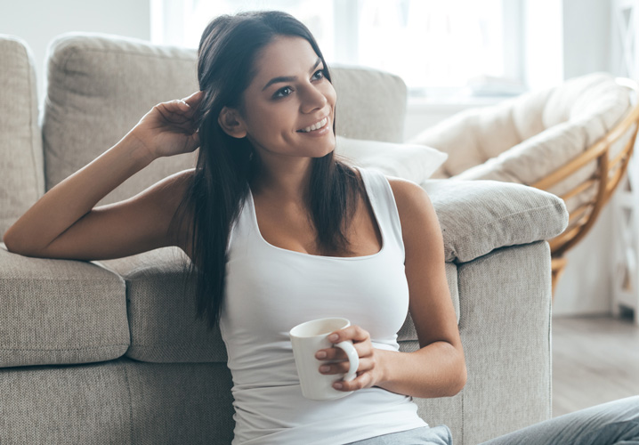 woman sitting in front of couch