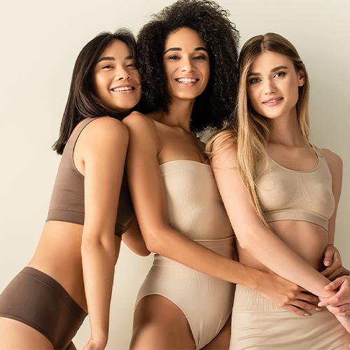three women posing smiling