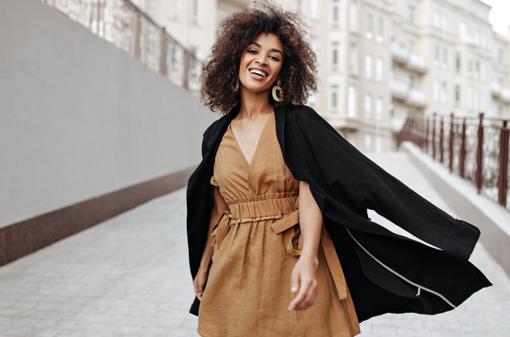 woman with flowing clothes smiling